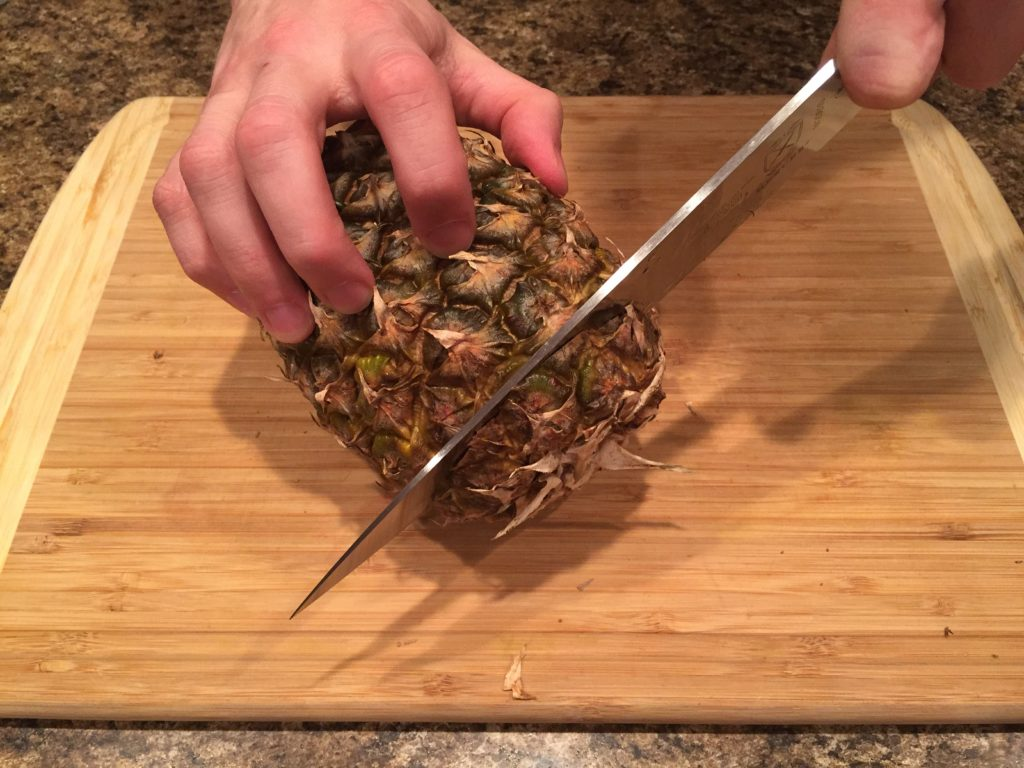Cut bottom of pineapple off